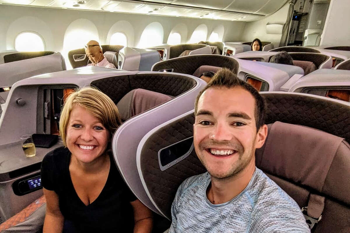 Airfare deals expert Jared Kamrowski, founder of ThriftyTraveler.com, is pictured here with his wife, Erica, on the way to Vietnam using points and miles.