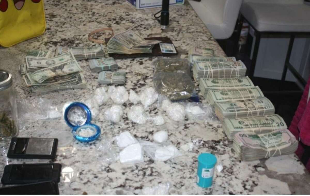 Laredo police said they seized the narcotics, cash and other items seen in this photo following the execution of two simultaneous search warrants.