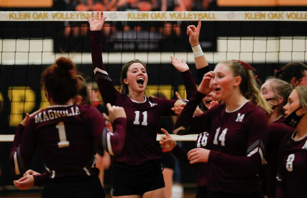 Magnolia setter Faith Lynch (11) celebrates with teammates after sweeping Porter in straight sets a Region III-5A bi-district high school volleyball playoff match at Klein Oak High School, Thursday, Nov. 19, 2020, in Spring.