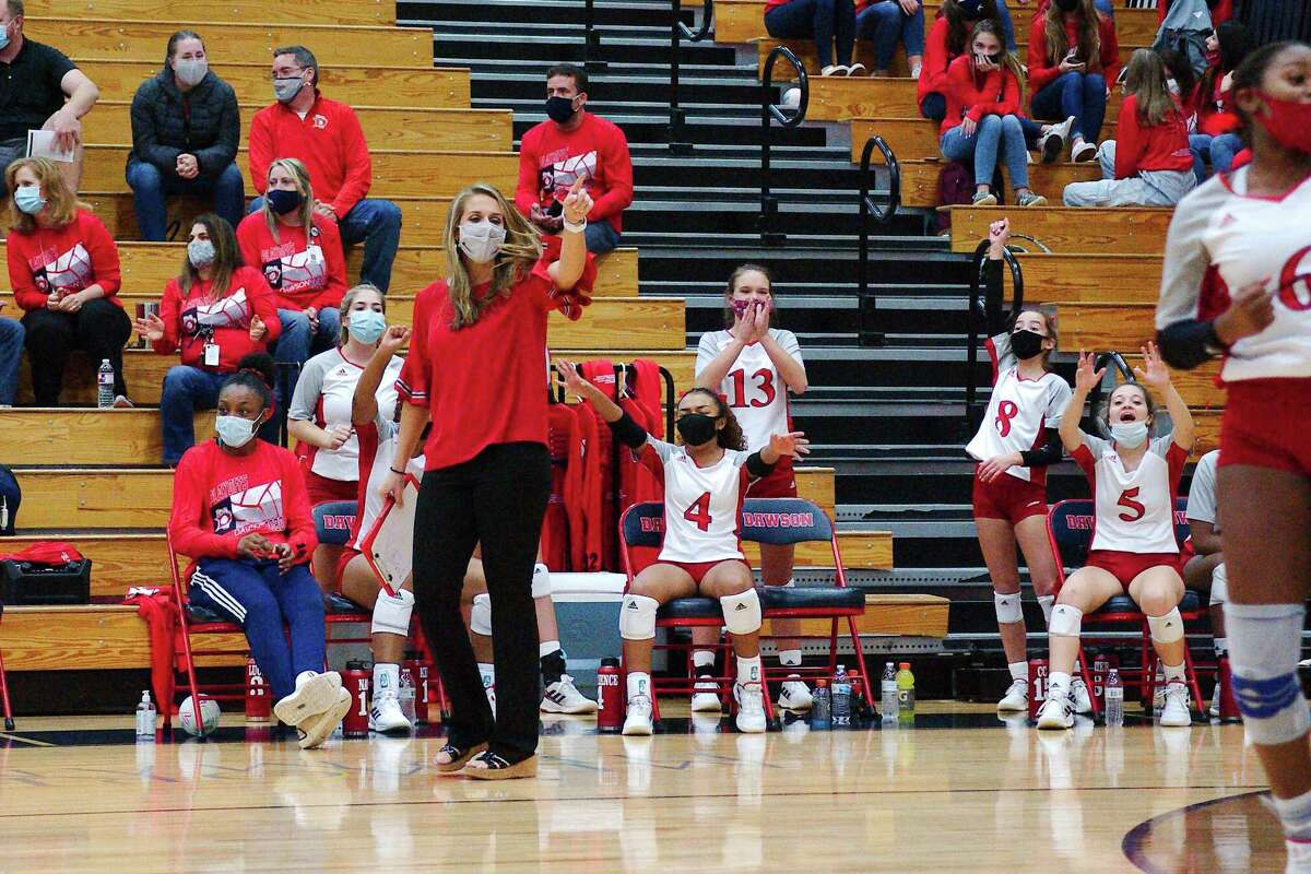 Dawson volleyball coach Lauren Leth and the Lady Eagles celebrate a point against Clear Lake Thursday, Nov. 19 at Dawson High School.