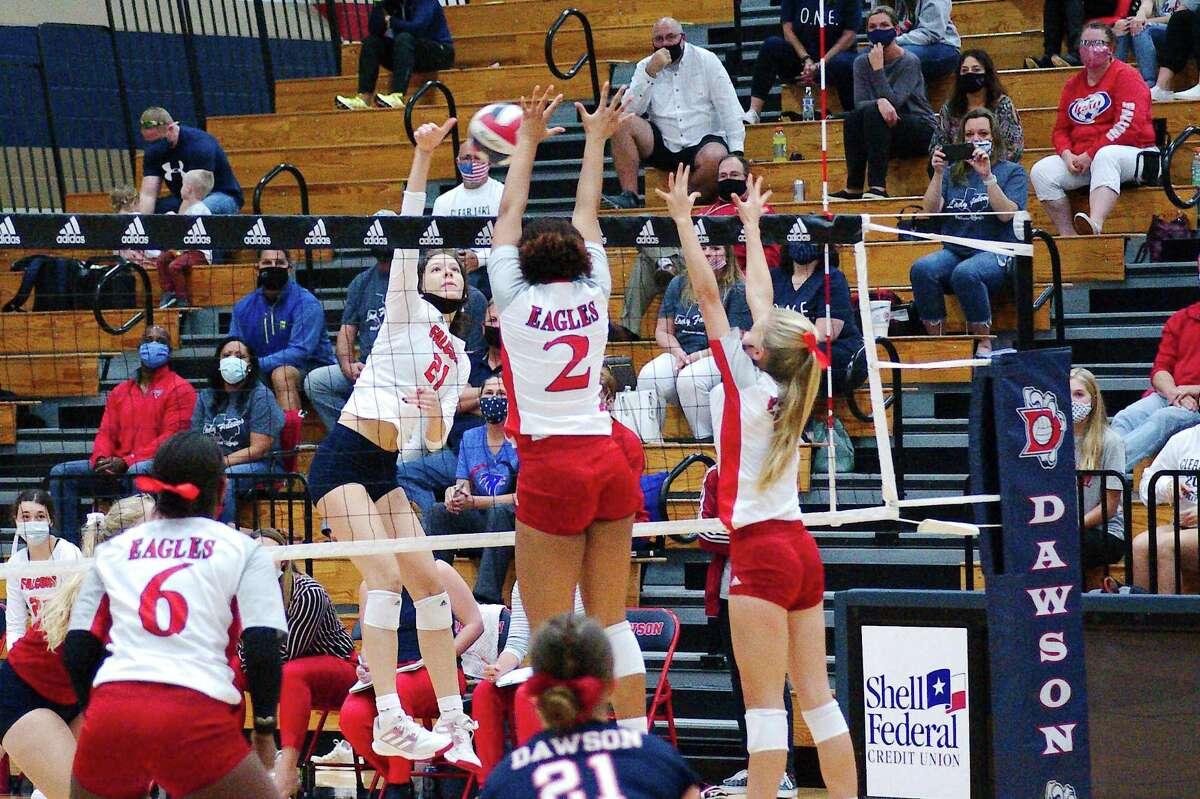 Clear Lake's Brooke Braham (21) tries to hit a shot past Dawson's Sydney Alexander (2) and Dawson's Bryce Ranney (9) Thursday, Nov. 19 at Dawson High School.