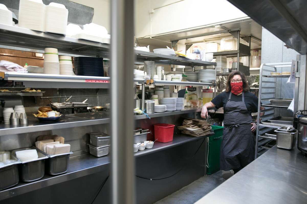 Owner Brenda Buenviaje stands inside her kitchen at Brenda's Meat and Three on Divisadero Street in San Francisco on Nov. 19, 2020. Like many other restaurants, Brenda's has been severely affected by the COVID-19 coronavirus pandemic.