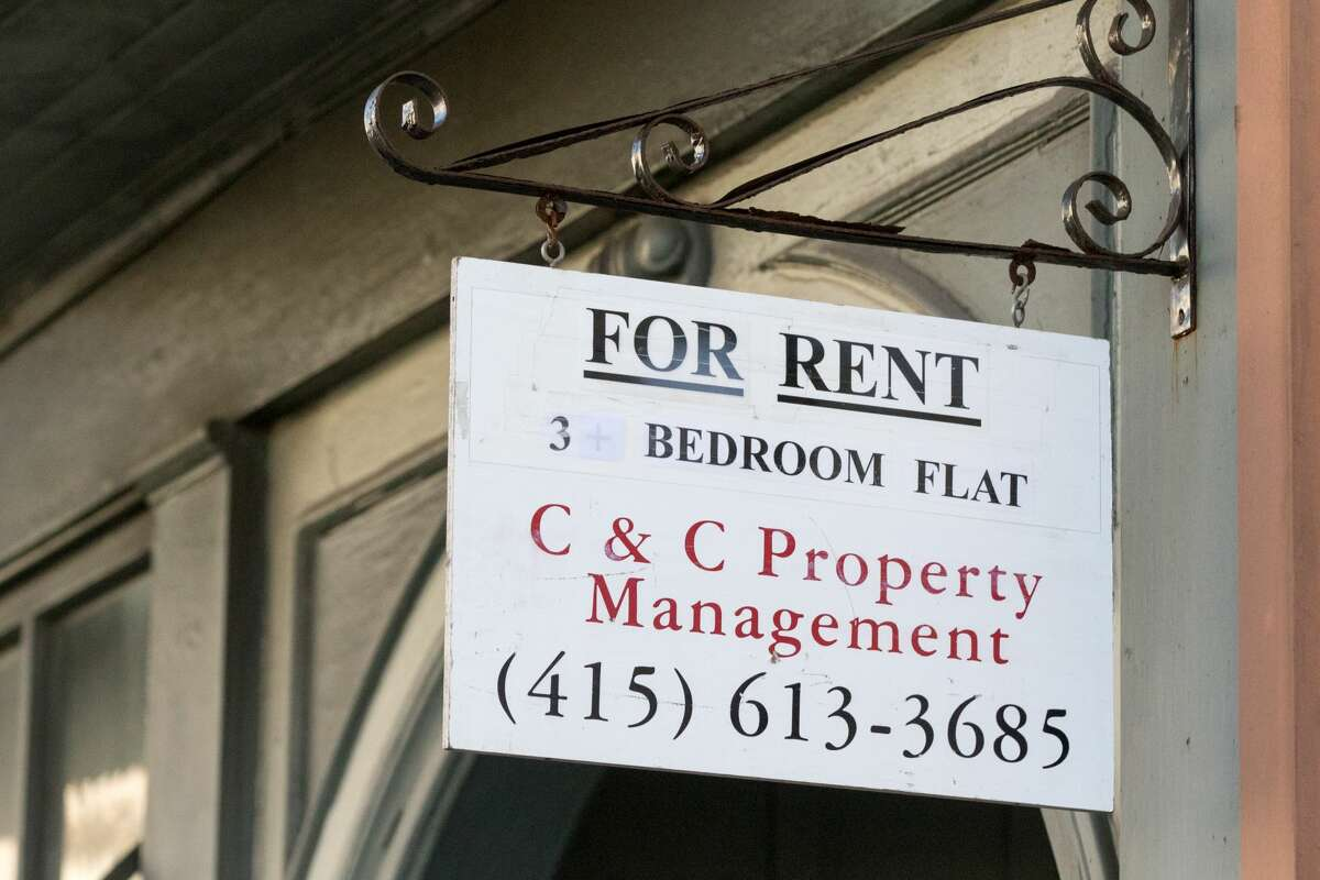 A for rent sign hangs outside an apartment building in San Francisco, California on November 19, 2020.