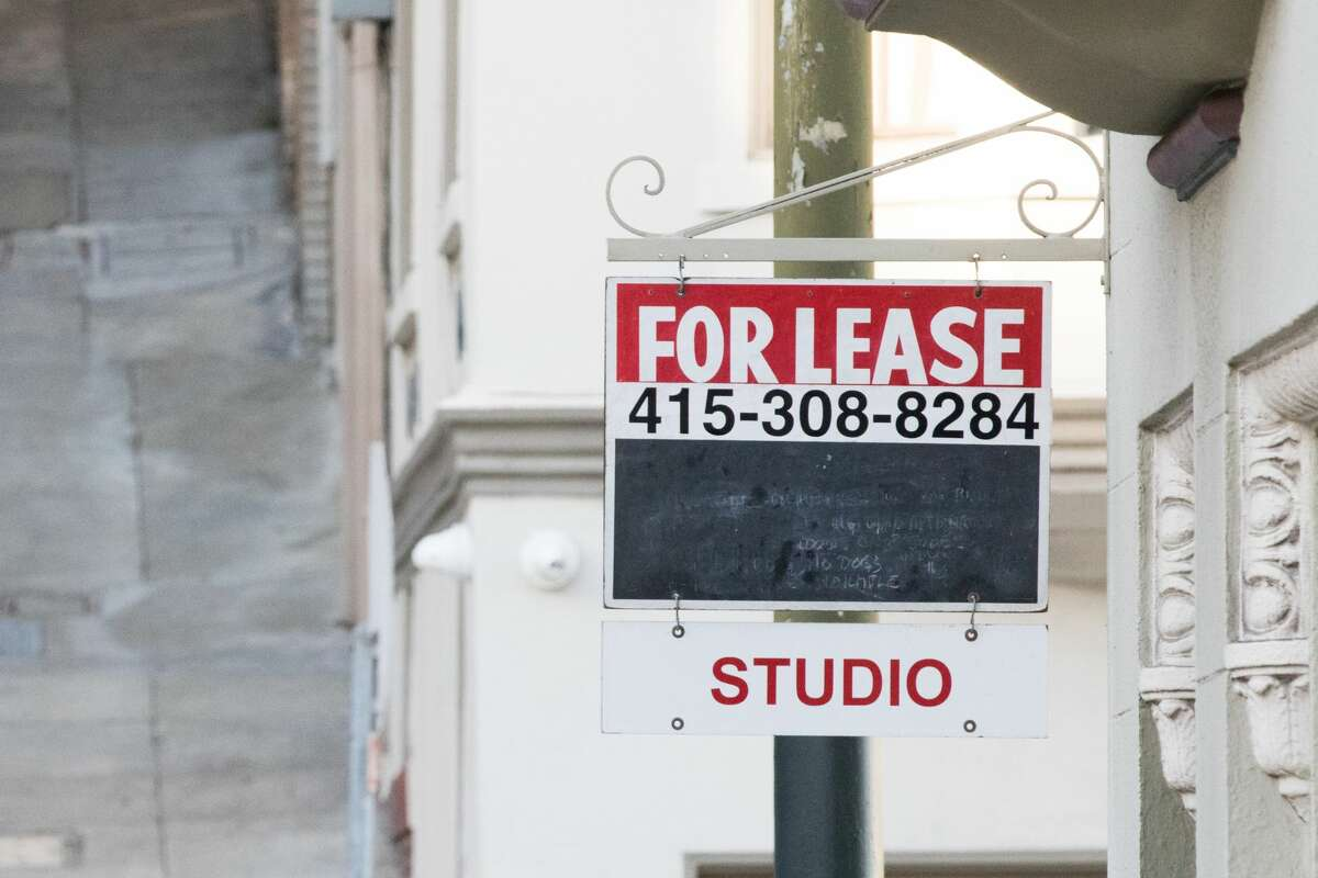 A for lease sign hangs outside an apartment building in San Francisco on Nov. 19, 2020.