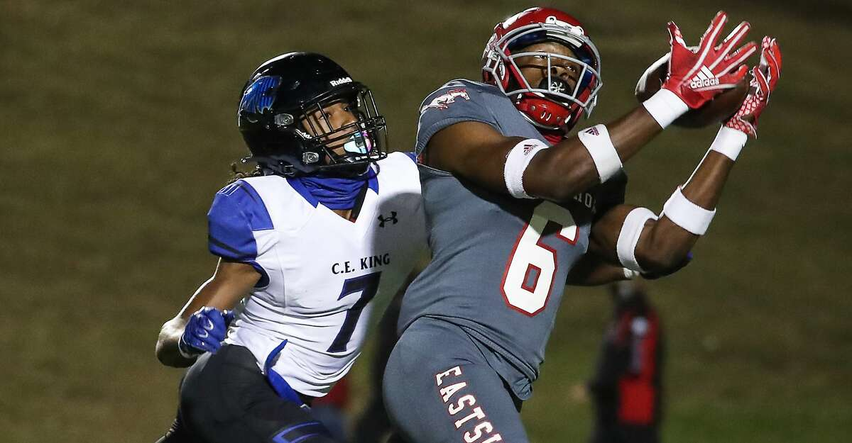 North Shore receiver Jhalyn Bailey (6) pulls down a first down reception against C.E. King cornerback Josiah Ruano (7) during a 21-6A high school football game at Galena Park ISD Stadium Thursday, Nov. 19, 2020 in Houston.