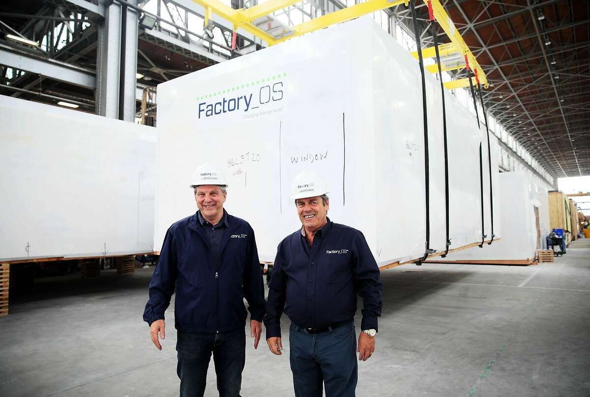 Rick Holliday (left), CEO of Factory_OS, and Larry Pace, the company's chief operating officer, at the company facility in 2019. The pandemic has dampened demand for new construction, posing a challenge to the startup.