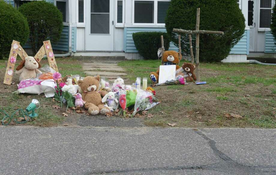 A memorial has been set up outside a Plymouth home where police say two children were shot Friday night. A 15-year-old was killed and a 7-year-old was seriously injured, police said. Photo: Peter Yankowski / Hearst Connecticut Media