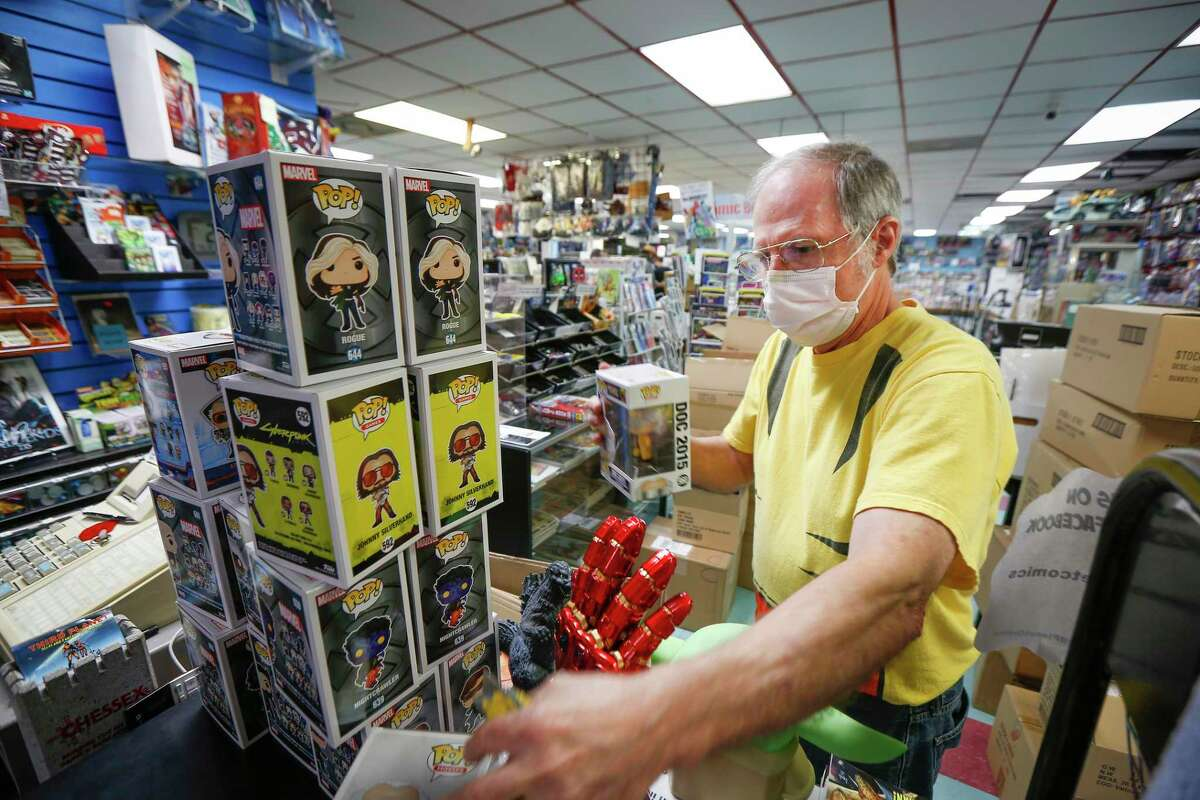 TJ Johnson, founder of Third Planet Comics, stocks new items in the Southwest Freeway mainstay that has been in the comic book business since 1975 Tuesday, Oct. 13, 2020, in Houston.