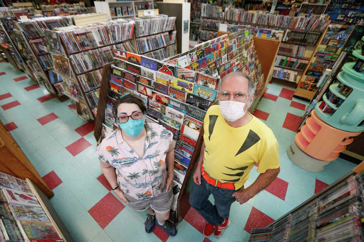 Stephanie McFall, general manager (left) and TJ Johnson, founder of Third Planet Comics, the Southwest Freeway mainstay that has been in the comic book business since 1975 photographer in their store Tuesday, Oct. 13, 2020, in Houston.