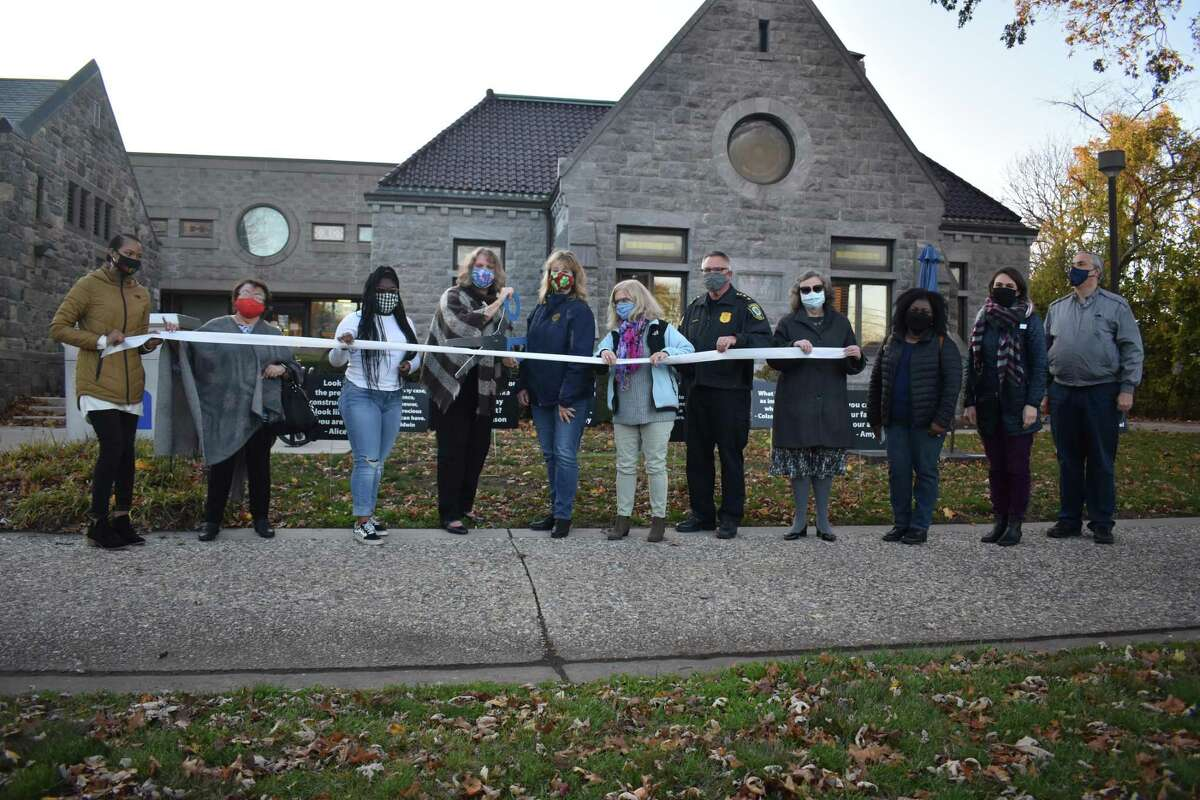 The Stratford Library held a ribbon-cutting Monday, Nov. 16, 2020 for an anti-racism exhibit of lawn signs featuring quotes from people of color.