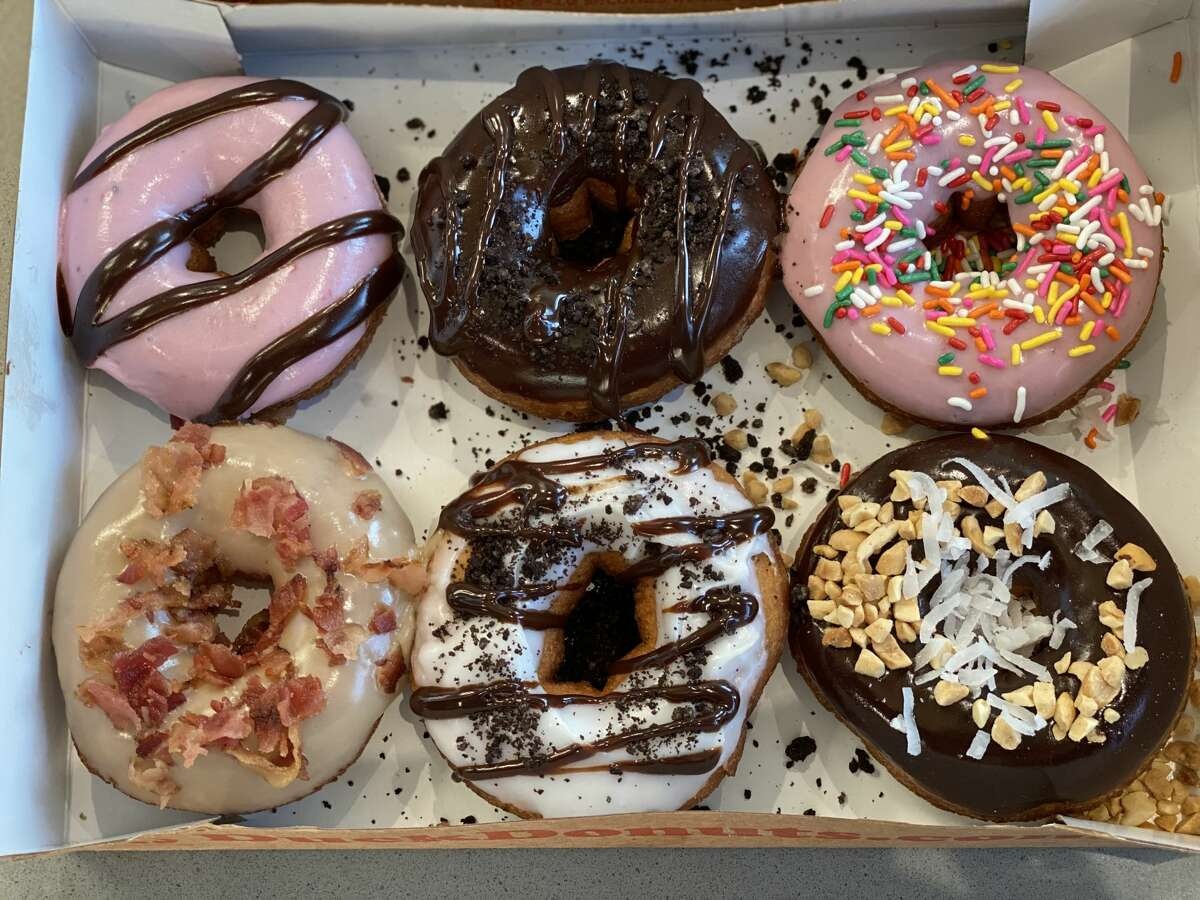 Custom doughnuts at Duck Donuts. The bakery is known for made-to-order doughnuts topped with frosting, cookies, nuts and more. The first of their shops in the Capital Region will open Saturday at Latham Farms.