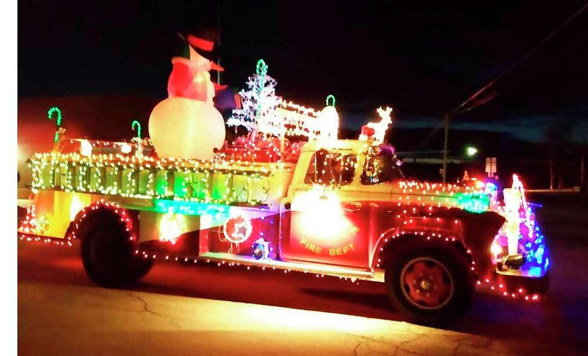 A giant snowman illuminates the city during last year's Harbor Beach Christmas Parade.