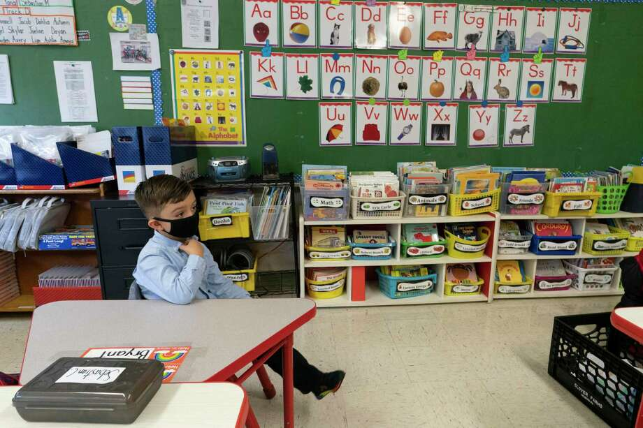 Students wear a face masks and are seated at a proper distance from their classmates in a kindergarten class in Yonkers, N.Y. Photo: Associated Press / Copyright 2020 The Associated Press. All rights reserved.