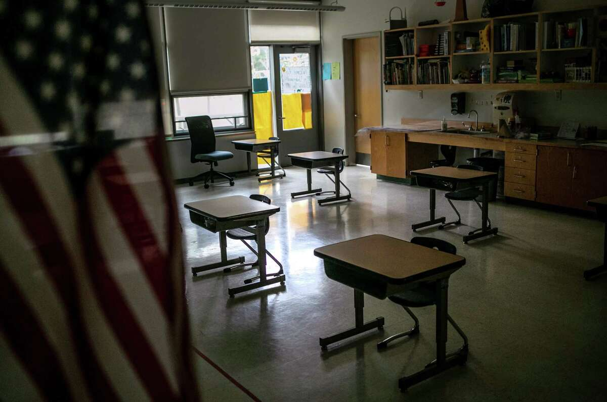 A Stamford classroom with desks arranged for social distancing awaits students, on October 21, 2020 in Stamford, Connecticut.