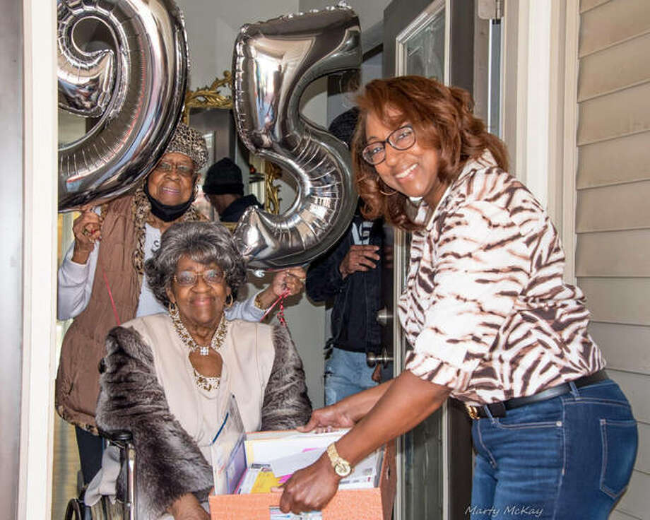 Choice L. Shepperd, 95, center, with her oldest niece Delores Kaiser, left, of Godfrey, on Shepperd's 95th birthday, Sunday, Nov. 1, and her youngest daughter, Rita Love, in Shepperd's doorway during a drive-by birthday parade of members of Shepperd's church, St. James Baptist Church, in Alton. Photo: Marty McKay|For The Telegraph