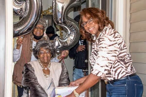 Choice L. Shepperd, 95, center, with her oldest niece Delores Kaiser, left, of Godfrey, on Shepperd's 95th birthday, Sunday, Nov. 1, and her youngest daughter, Rita Love, in Shepperd's doorway during a drive-by birthday parade of members of Shepperd's church, St. James Baptist Church, in Alton.
