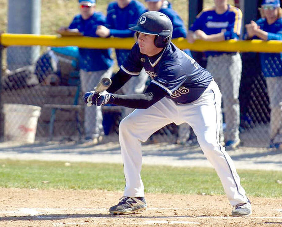 Principia's Will Adler attempts a bunt last season against Spalding College. The St. Louis Intercollegiate Athletic Conference has released its schedule of 2021 spring sports. Photo: Principia Athletics