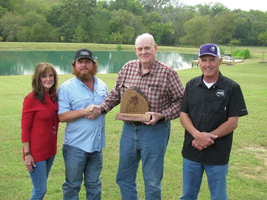 Dave Duren, Texas Logging Council Coordinator; and Bob Harper, consulting forester; present the 2020 Outstanding Logger of the Year award to Deaven Futral and Kelly Underwood during the TFA virtual annual meeting held Oct 28-29 at their headquarters in Lufkin. Photo: Photo Courtesy The Texas Forestry Association