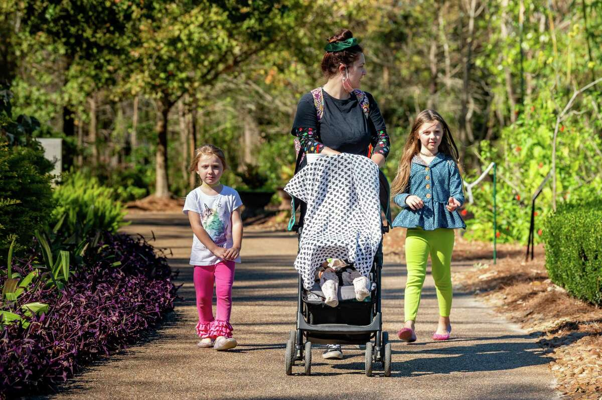 Paisley, 5, Olivia, and Madi Moody, 6, took a walk through the gardens paying special attention to the pretty flowers. Shagri La Botanical Gardens and Nature Center in Orange reopened to visitors Wednesday, having been closed for the pandemic and repairs after Hurricane Laura. Photo made on November 18, 2020. Fran Ruchalski/The Enterprise