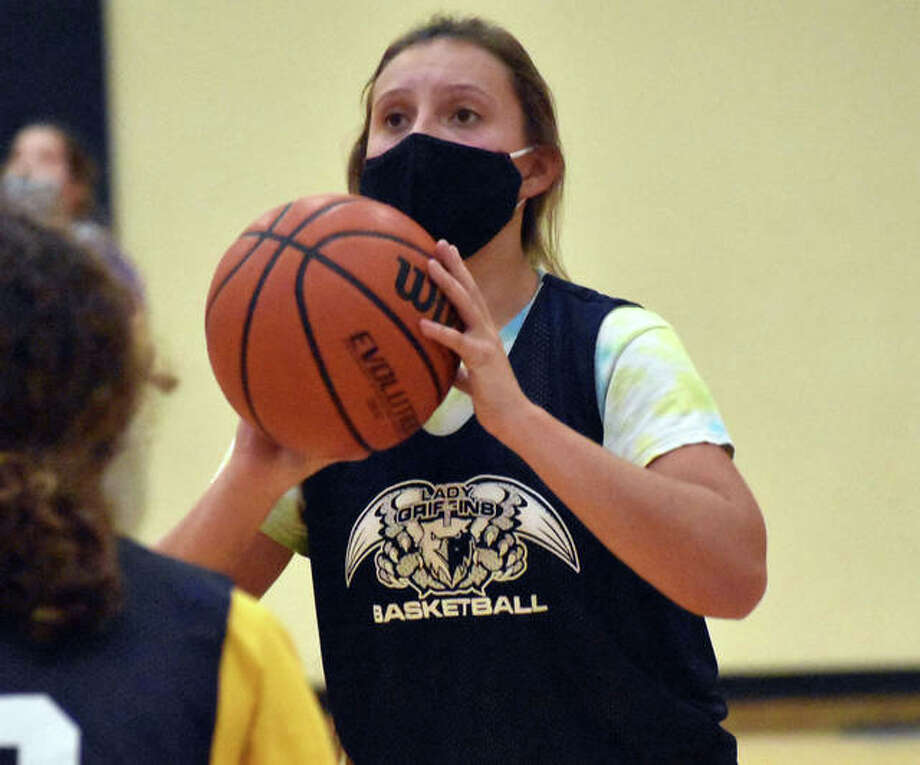 Father McGivney junior Grace Stanhaus puts up a shot during practice on Monday for the Griffins. She is overcoming two knee surgeries the last two years and is hoping to play in her first game this upcoming season. Photo: Matt Kamp|The Intelligencer