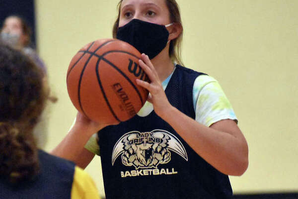 Father McGivney junior Grace Stanhaus puts up a shot during practice on Monday for the Griffins. She is overcoming two knee surgeries the last two years and is hoping to play in her first game this upcoming season.