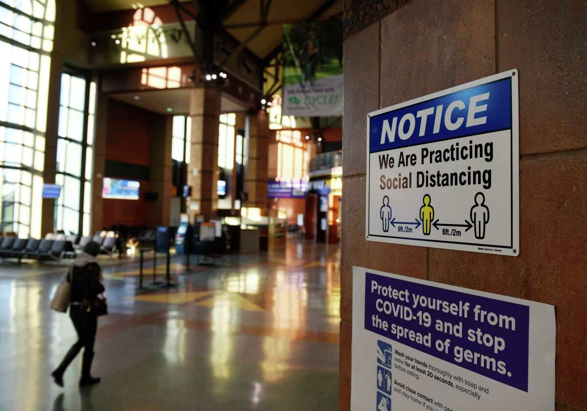 Signs warn passengers to take coronavirus precautions at the Albany-Rensselaer Amtrak station on Thursday, Nov. 19, 2020, in Rensselaer, N.Y. (Will Waldron/Times Union)