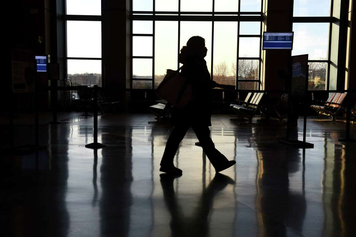 A masked passenger walks through the Albany-Rensselaer Amtrak station on Thursday, Nov. 19, 2020, in Rensselaer, N.Y. (Will Waldron/Times Union)