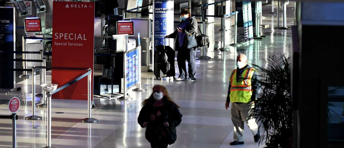 Passengers and staff make their way through the the terminal at Albany International Airport on Thursday, Nov. 19, 2020, in Colonie, N.Y. (Will Waldron/Times Union)