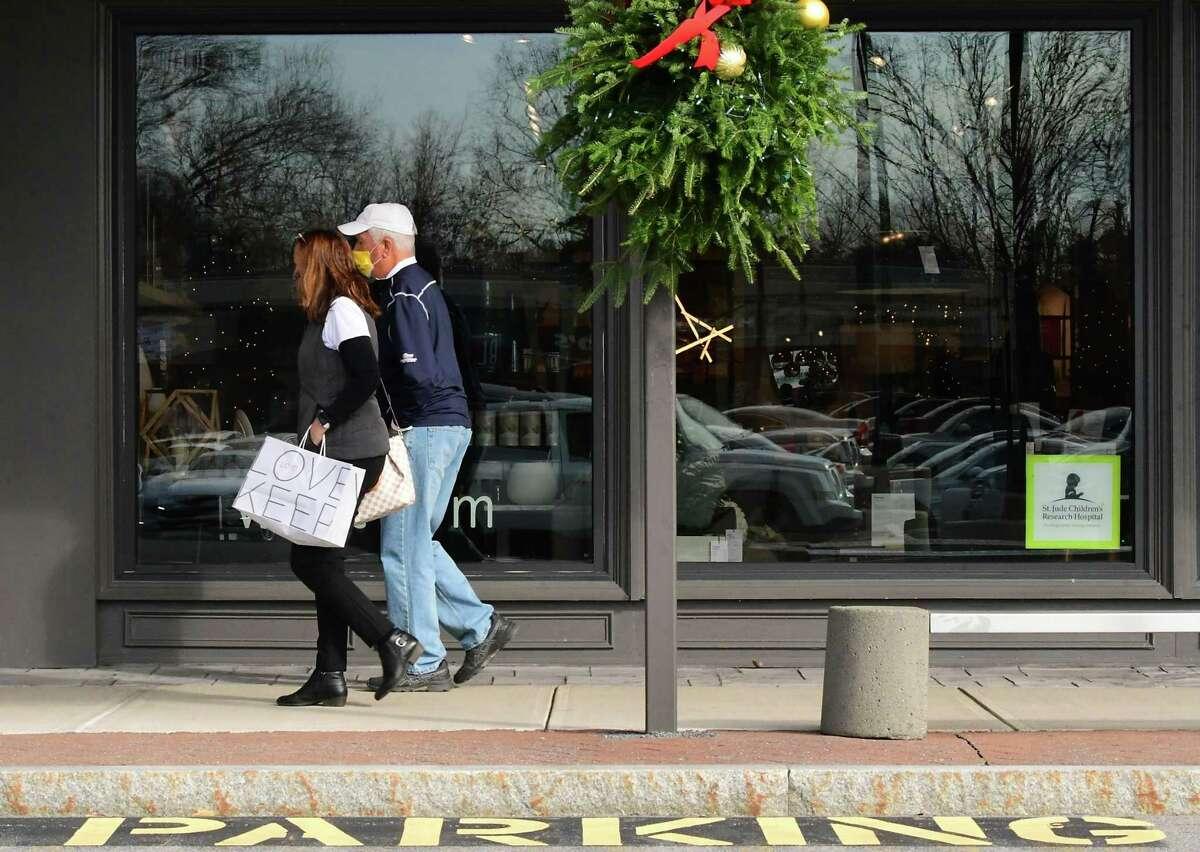 Shoppers walk along the sidewalk at Stuyvesant Plaza on Friday, Nov. 20, 2020 in Albany, N.Y. (Lori Van Buren/Times Union)
