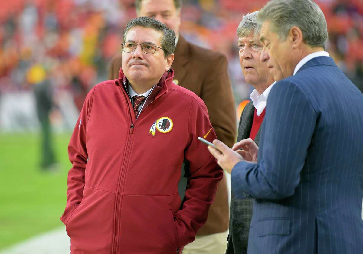Washington Football Team owner Daniel Snyder, left, with part owners Dwight Schar, center, and Robert Rothman. A dispute among the team's owners has spilled into federal court.