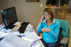 2:20 p.m. - Sanford Village President Dolores Porte works at her home office on Monday, Oct. 19, 2020 in Sanford. (Katy Kildee/kkildee@mdn.net)