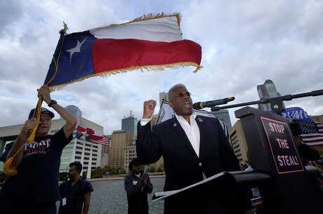 Texas GOP chairman Allen West, right, speaks to supporters of President Donald Trump during a rally in front of City Hall in Dallas, Saturday, Nov. 14, 2020. (AP Photo/LM Otero)