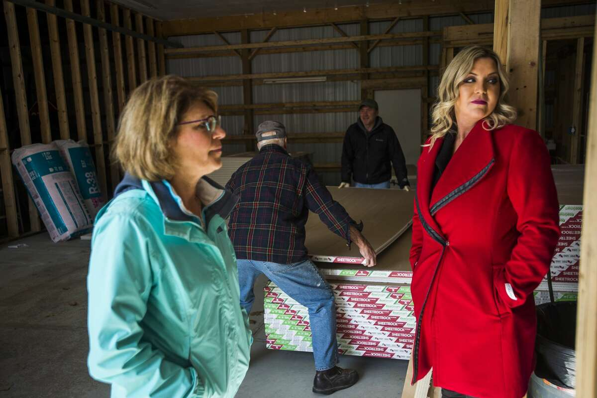 Sanford Village President Dolores Porte, left, chats with Teresa Quintana of the Sanford Strong group, right, as free drywall is distributed to Sanford residents in need on Monday, Oct. 19, 2020 at the Department of Public Works. (Katy Kildee/kkildee@mdn.net)