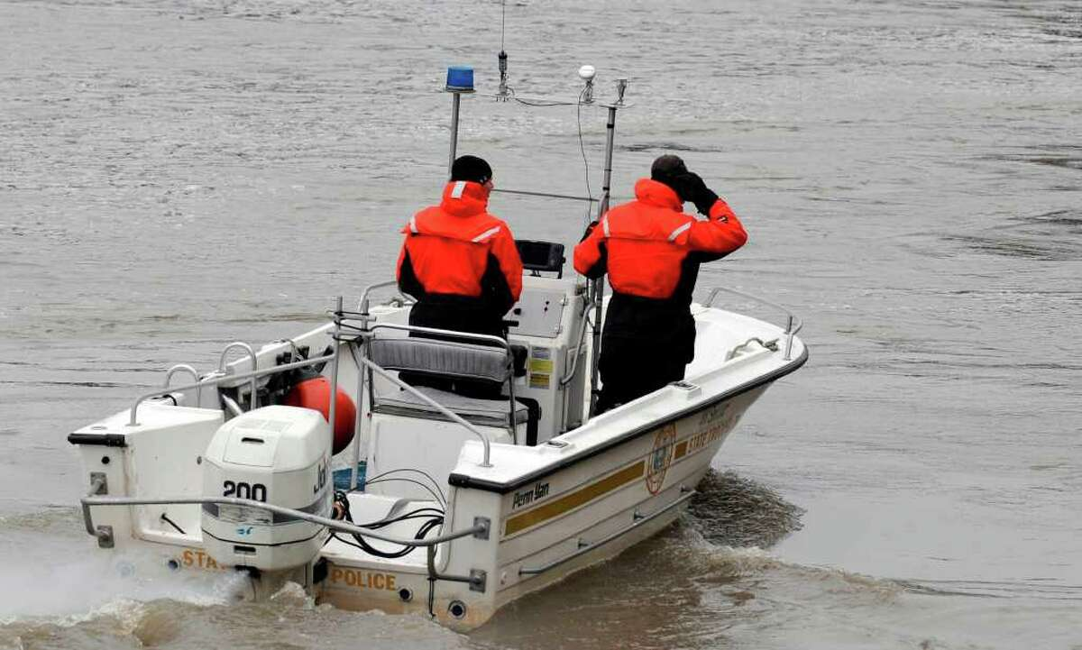 New York State Police trooper Tim Hard, right, and Mike Phelps, left, use a sonar device to look in to the depths of the Hudson River in Troy, New York, where a water search is taking place for Jaliek Rainwalker February 7, 2008. Rainwalker has been missing since November 1, 2007. (Skip Dickstein / Times Union)