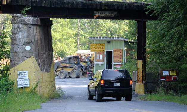 A local police vehicle drives behind a train trestle in near the Battenkill as State Police conduct a search for Jaliek Rainwalker, the then 12-year-old Greenwich boy who disappeared in 2007.  (Skip Dickstein/Times Union) Photo: Skip Dickstein