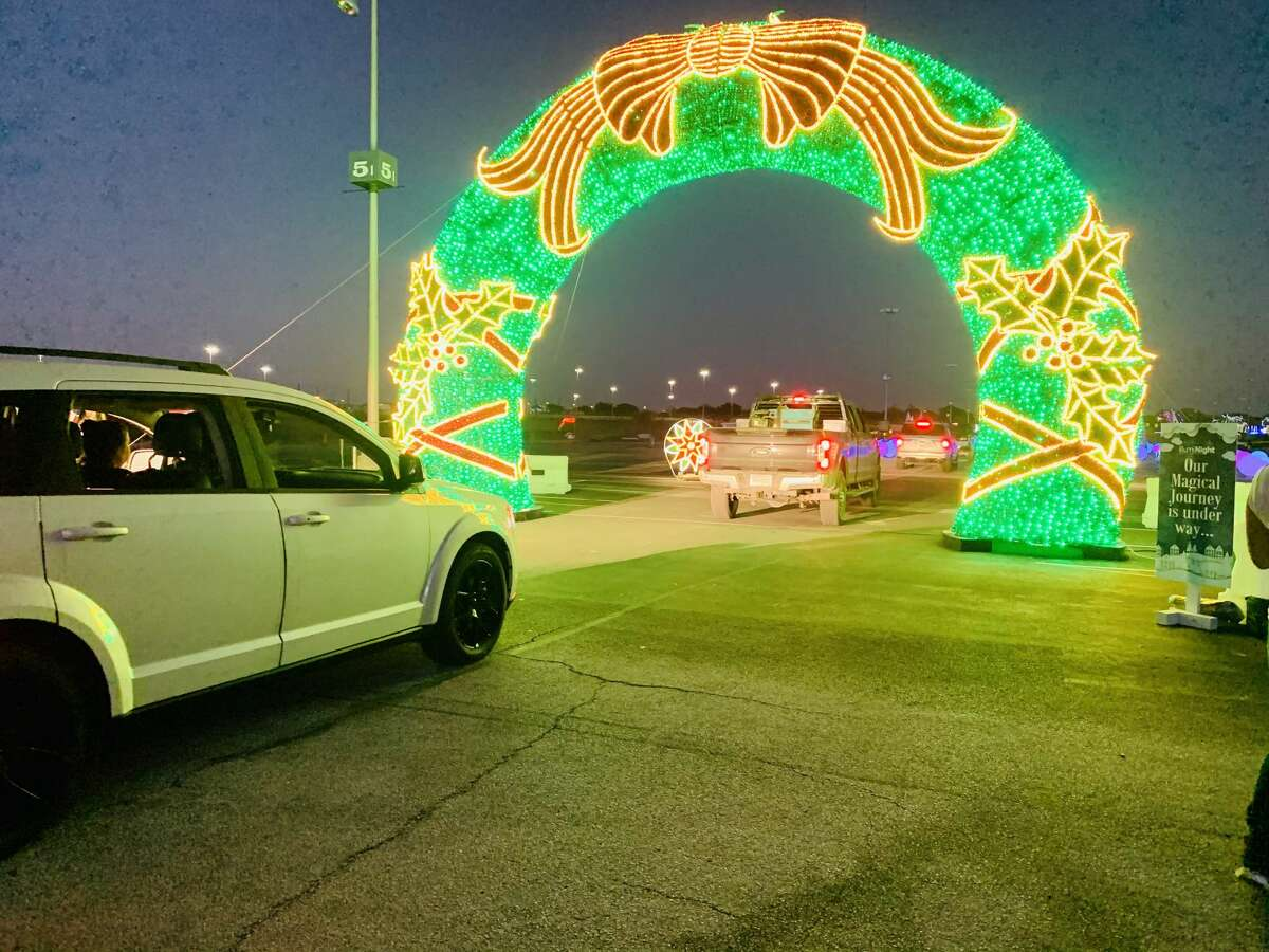 Guests enter the AT&T Center grounds, where people usually park for Spurs games and concerts, through Gate D off of AT&T Center Parkway. A huge wreath, which was lit by the Spurs Coyote, greets cars to begin the journey.
