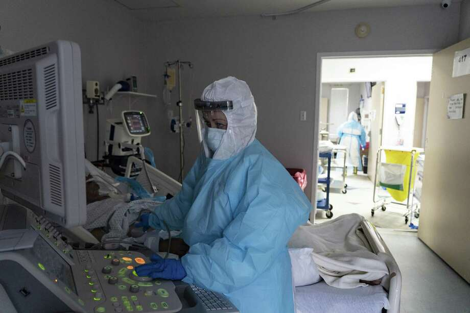 A medical staff member checks a monitor while treating a patient at the COVID-19 Intensive Care Unit in United Memorial Medical Center in Houston. A proper presidential transition would go a long way in addressing COVID-19 in America and saving lives. But that's not happening. Photo: Go Nakamura /Bloomberg / © 2020 Bloomberg Finance LP