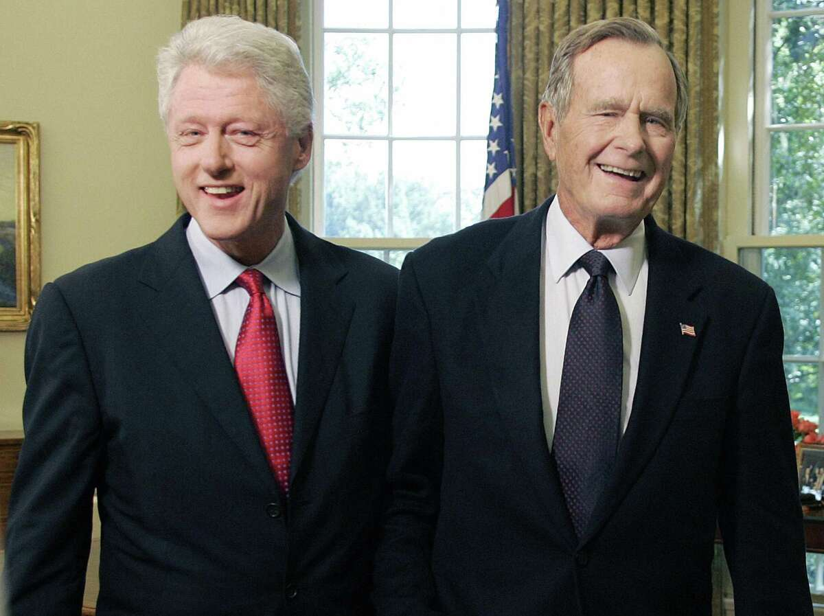 Former Presidents George H.W. Bush and Bill Clinton visit the Oval Office in 2005. The two ex-presidents modeled the peaceful transfer of power so necessary in our democracy.