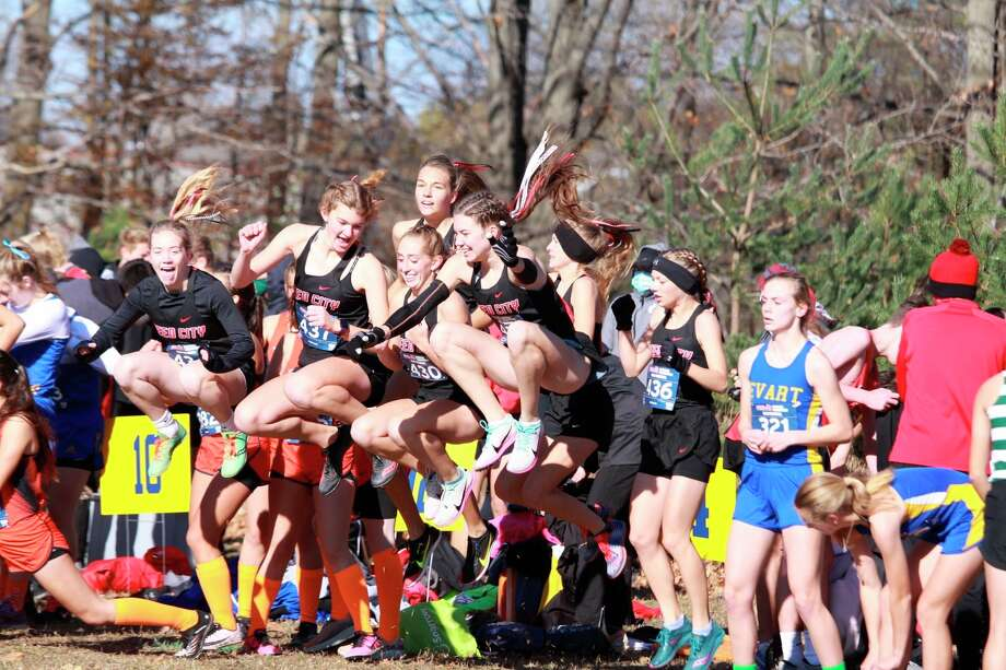 The Reed City girls cross-country team prepares for a race earlier this season. (Courtesy photo)