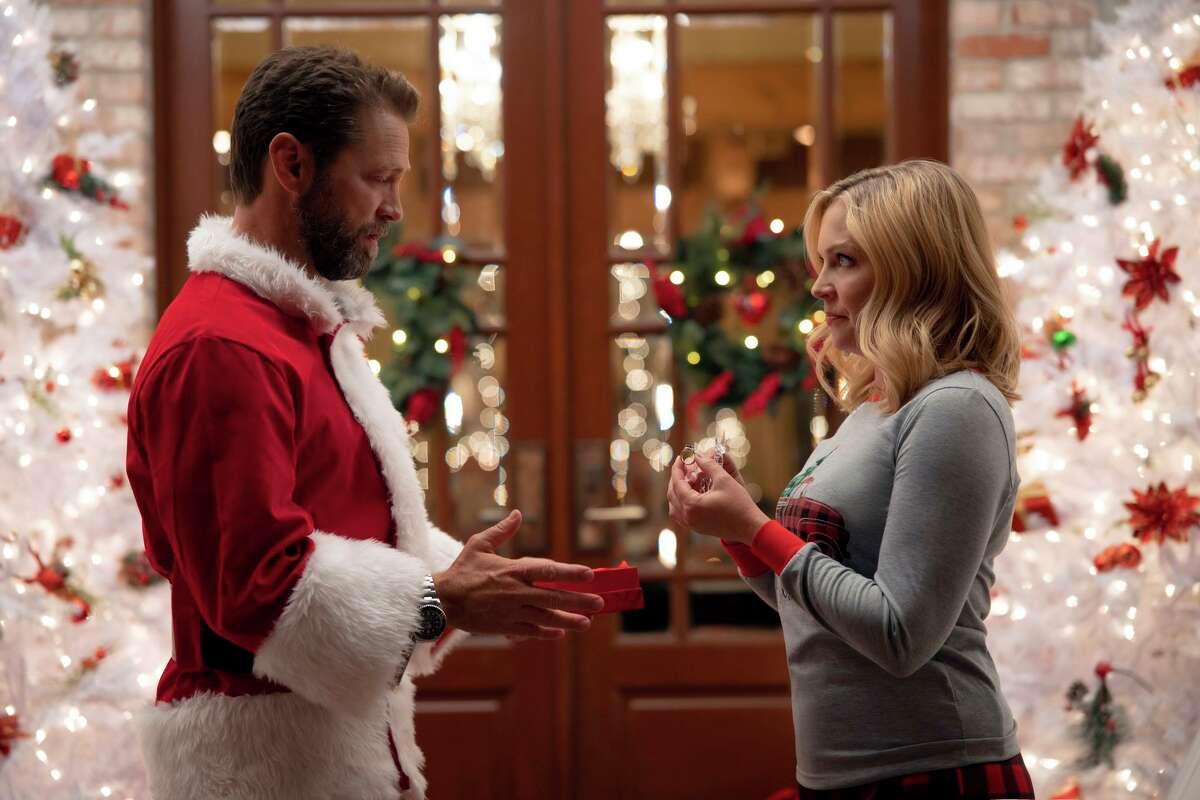 "Jason Priestley, left, and Melissa Joan Hart star in ""Dear Christmas,"" premiering Nov. 27 at 8 p.m. on Lifetime."