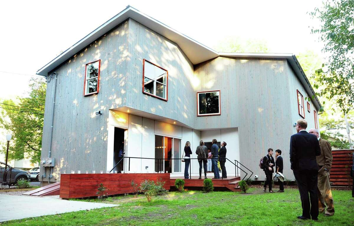 The Vlock Building Project, a two-family house designed and built by Yale architecture students in partnership with Neighborhood Housing Services, on Newhall St. in New Haven was dedicated on 10/1/2012. Photo by Arnold Gold/New Haven Register