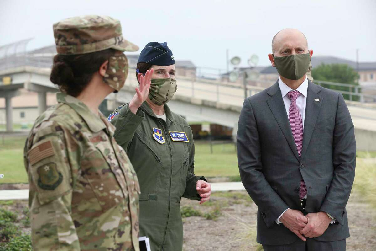 Acting Undersecretary of the Air Force Shon Manasco, right, talks with Col. Becky Blackwell, Commander of the 559th Medical Group at Joint Base San Antonio-Lackland, Wednesday, April 22, 2020. Manasco toured the base to observe the Restriction-of-Movement flight training.