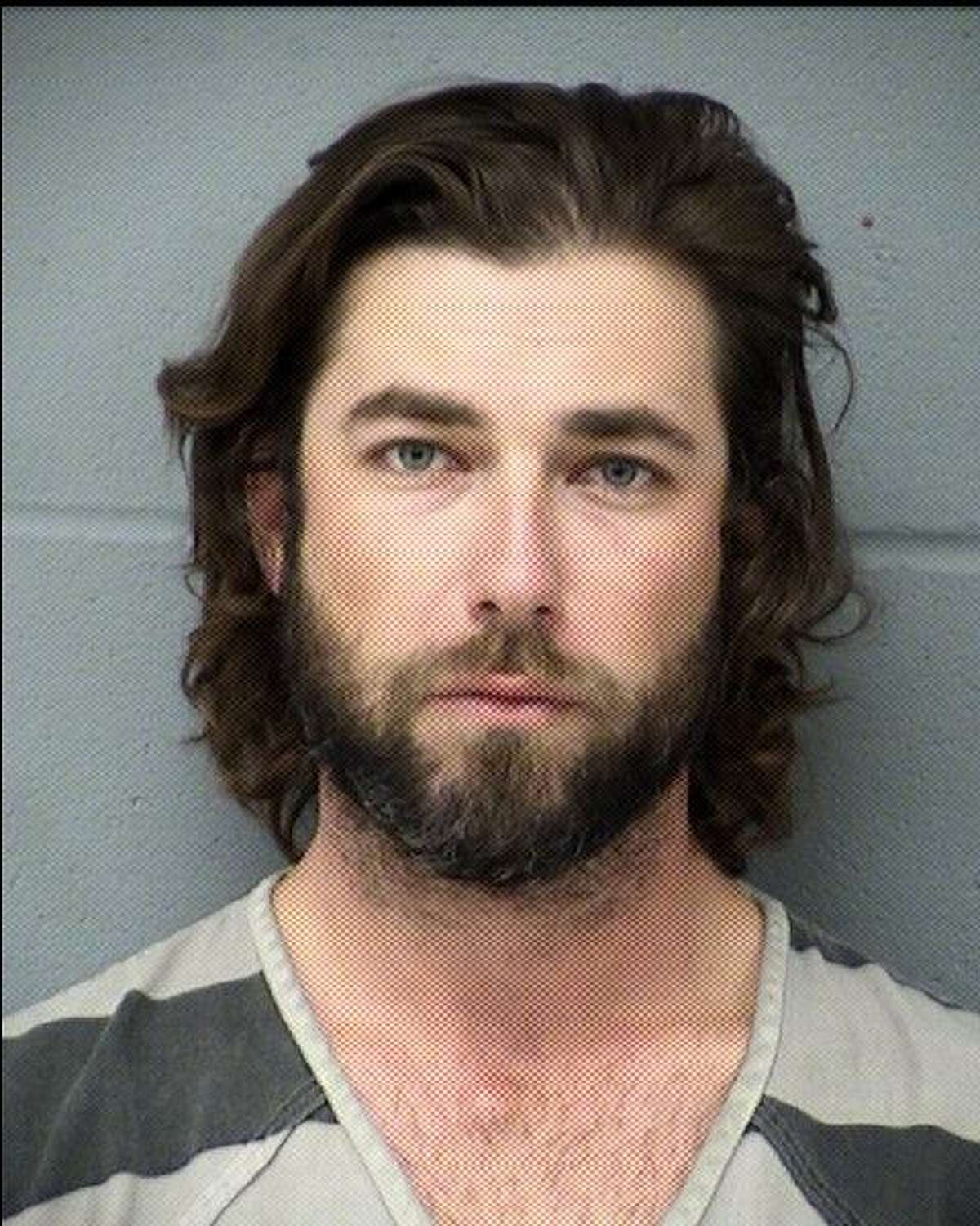 Charles Edward Wheeler, 33, of Austin, who came under scrutiny when his girlfriend and her two daughters were found shot to death in his former home in Bexar County almost two years ago, was arrested Thursday by Austin police and charged with driving while intoxicated.