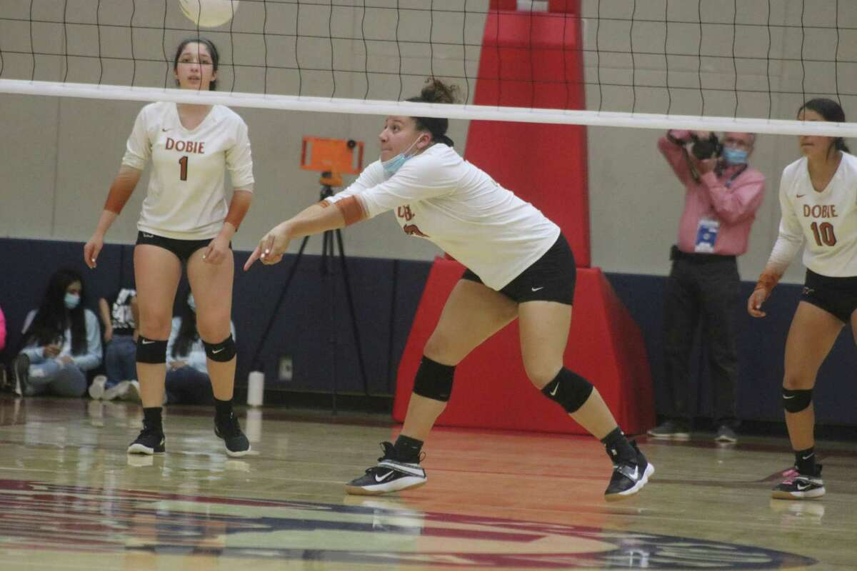 Dobie's Madai Saurez bumps the ball up for a teammate during the team's attempt to stave off elimination Thursday night.