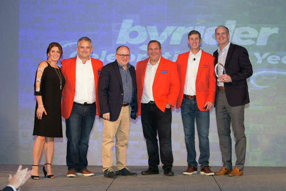Jeff Anderson (first from right), Mike France (third from the left), their team and Byrider leadership are recognized at the 2019 Byrider convention