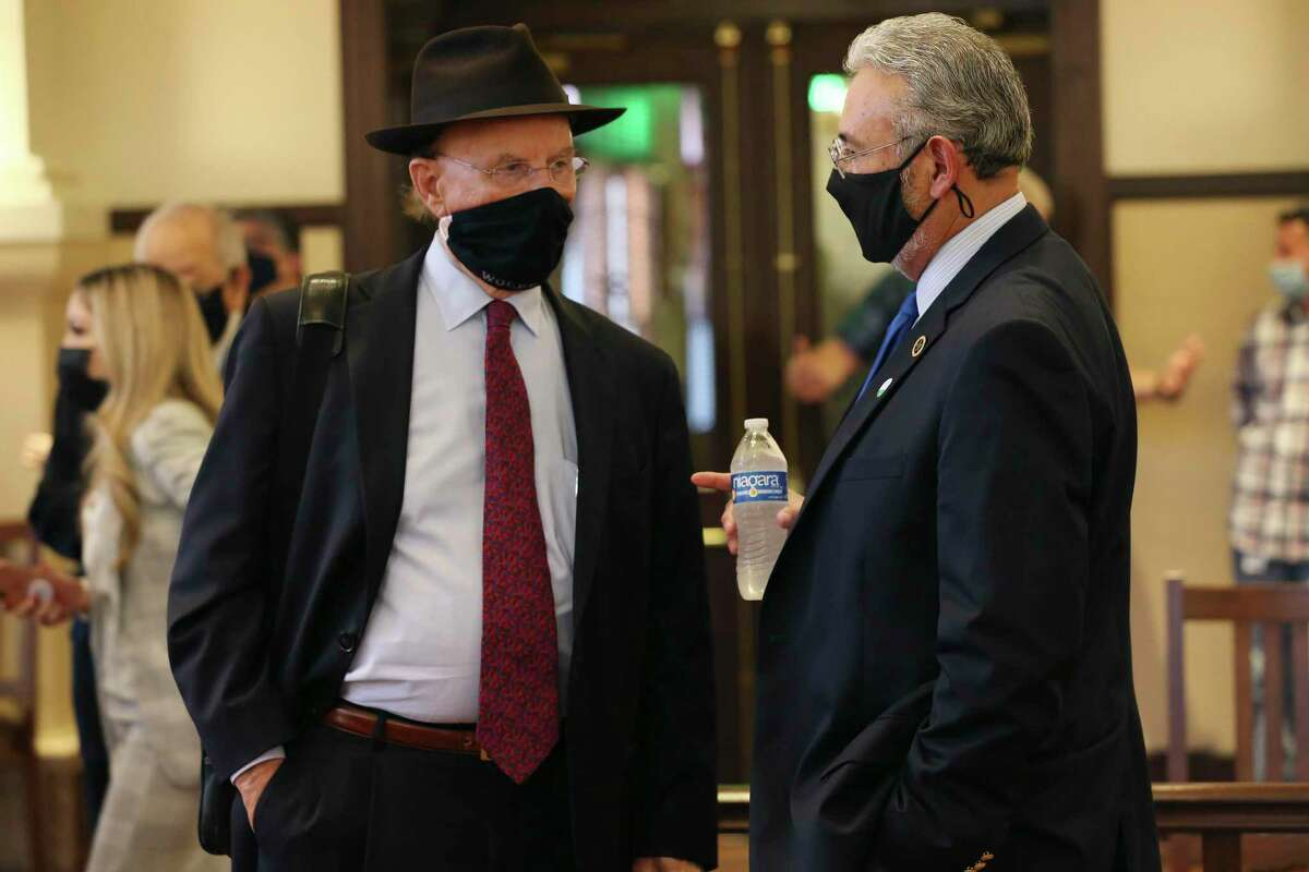 Bexar County District Attorney Joe Gonzales, right, talks with Bexar County Judge Nelson Wolff before a press conference Friday. Gonzales and Wolff announced the addition of more judges to handle domestic violence cases.