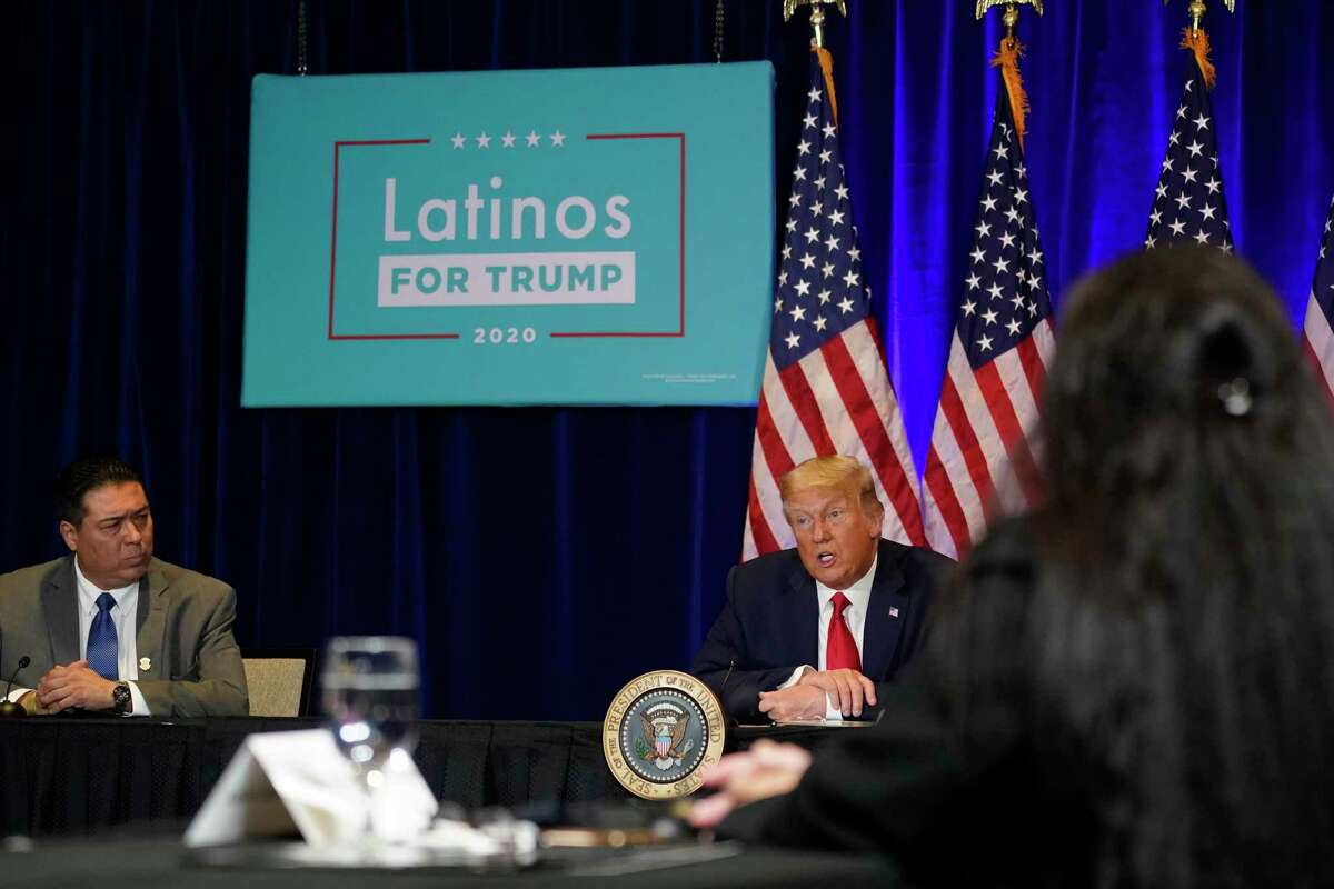 President Donald Trump attends a Latinos for Trump Coalition roundtable in Las Vegas in September. After the election, people keep asking about the