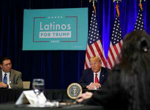 "President Donald Trump attends a Latinos for Trump Coalition roundtable in Las Vegas in September. After the election, people keep asking about the ""Latino vote,"" when it might be wiser to ask Latinos about specific issues."
