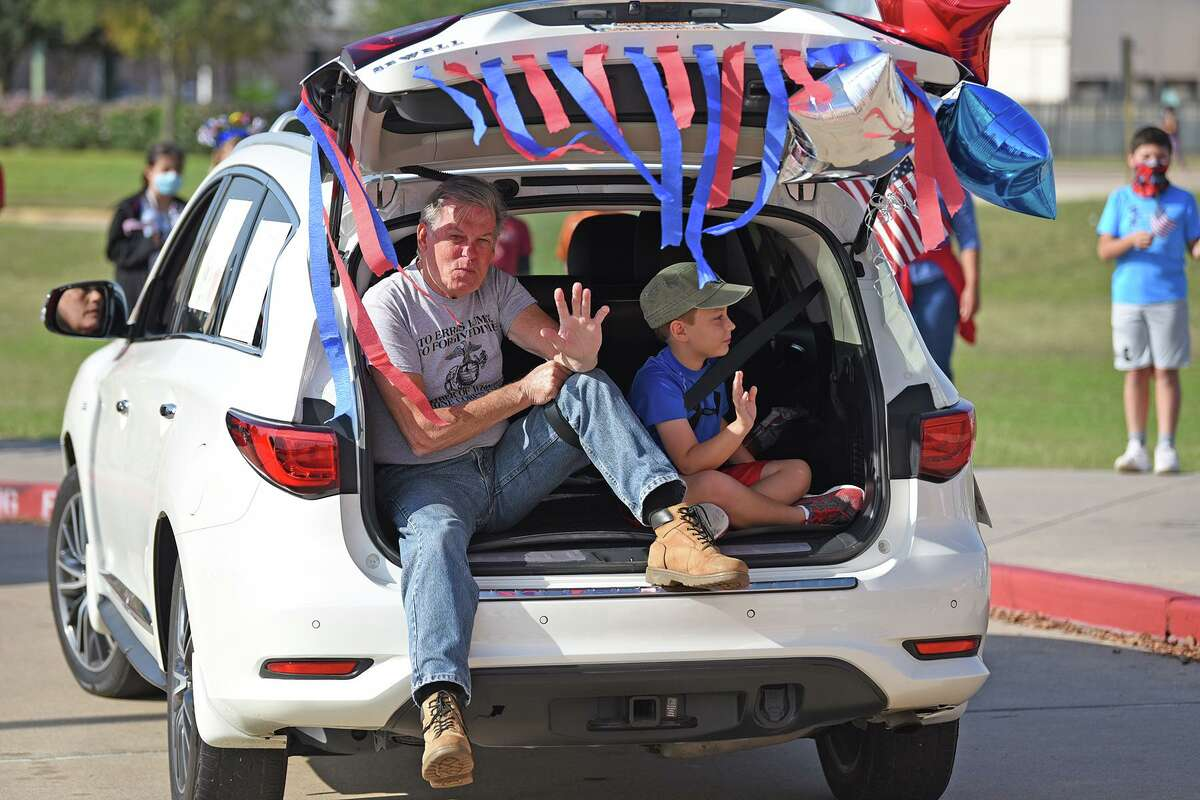 A drive-thru parade honoring veterans is held Nov. 11, 2020 at A. Robison Elementary School in Cy-Fair ISD.