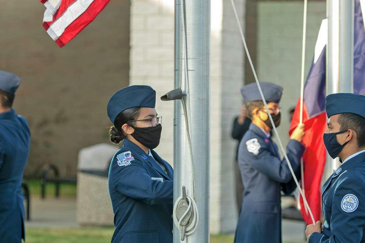 The American flag is raised during a Veterans Day Ceremony Nov. 11, 2020 by Cy Creek senior Larissa Sarabia (left) and sophomore Daniel Macias.